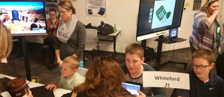 Students from Mrs. Mills' class discuss technology in the classroom with local business and education leaders