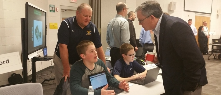 Students from Mr. Manley's class discuss technology in the classroom with local business and education leaders.